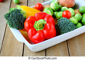 fresh vegetables and cooking utensils
