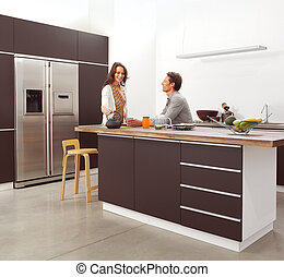 couple in the modern kitchen