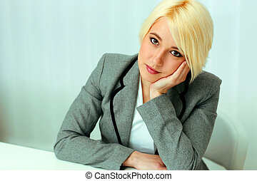 Closeup portrait of a thoughtful beautiful business woman in...