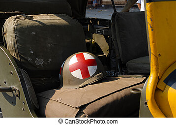 world war two helmet placed on the military truck - world...