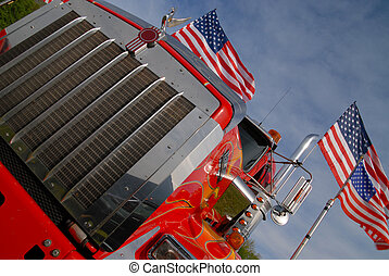 chrome grille of an American truck with us flags