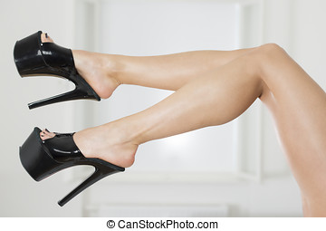 Long and sexy legs in extreme platform shoes