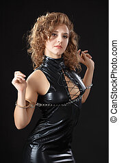 BDSM. Girl in latex with handcuffs