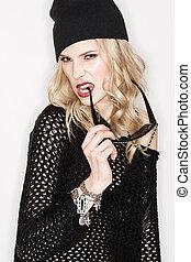 Fashion portrait of sexy woman with black dress