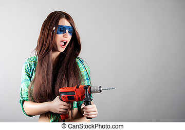 Sexy woman with power drill - portrait of sexy woman with...