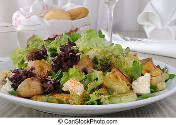 Salad with mushrooms with zucchini, cheese in lettuce leaves