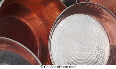 Shiny Copper Pots Dolly - Close up dolly shot of...