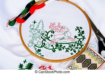 Christmas embriodery. - White tablecloth in a round frame...