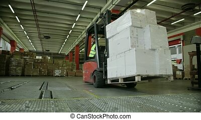 4of19 People working in warehouse - Logistics business and...
