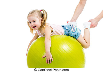 mother doing gymnastics with kid on fitness ball