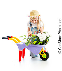 kid girl with potted flowers and gardening equipment...