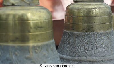 Decorative Brass Bells Dolly - Close up dolly shot of...