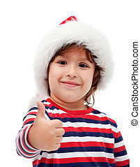 Little boy giving you thumbs up - Little boy with santa hat...