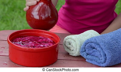 spa in garden - spa at home in garden woman fills bowl full...