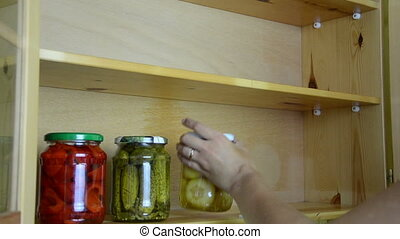 kitchen jar vegetable - woman neatly align various pickles...