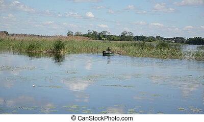 man row rowboat lake - Man row sail on lake with rowboat...
