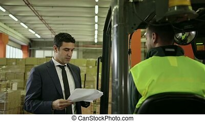 10of19 People working in warehouse - Businessman in shipping...