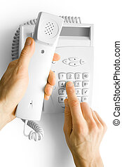 telephone with hands - dialing phone number. telephone with...