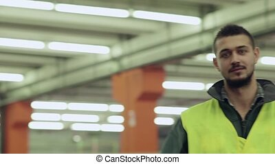15of19 People working in warehouse - Portrait of happy young...