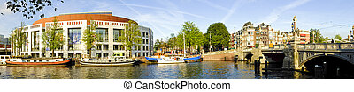 Panorama from Amsterdam innercity with the Amstel in the...