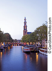 Amsterdam by night with the Westerkerk in the Netherlands
