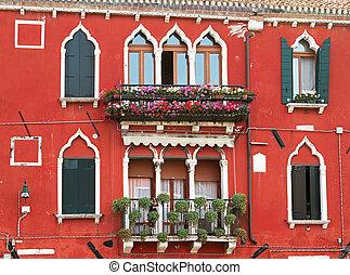 Red vintage facade in Venice.
