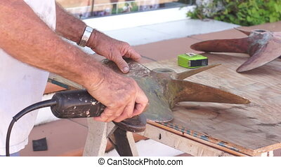 Boat Prop Maintenance Dolly - Close up, dolly shot of a man...