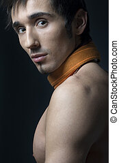 Young fashion male model with athletic body posing in...