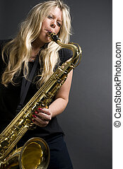 sexy blond female saxophone player musician - sexy blond...