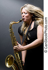 sexy blond female saxophone player musician