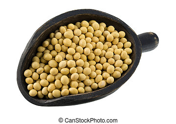 scoop of yellow soy beans - yellow soy beans on a primitive,...