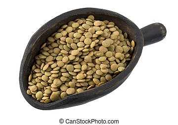 scoop of green lentils - green lentils on a primitive,...
