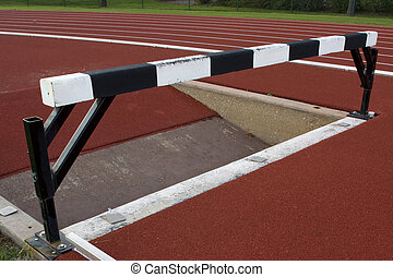 running tracks with steeplechase barrier and water jump