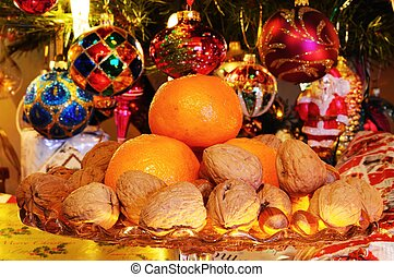 Christmas fruit and nuts - Glass plate stand topped with...