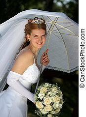 Smiling bride under parasol