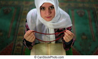 Muslim girl praying - Muslim girl saying her everyday salat...