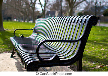 Metal Park Bench - metal park bench tanken at an angle in...