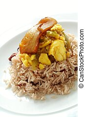 saltfish and ackee with plantain on peas rice