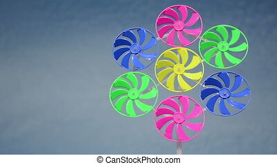 colorful wind mill spin - Colorful plastic wind mills spin...