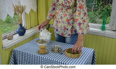 mint tea teaspoon - rural homesteads room girl prepares...