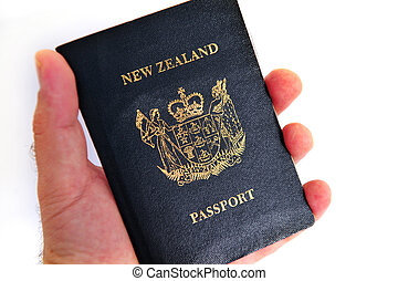 New Zealand passport - AUCKLAND - SEP 20:Mans hand holds old...