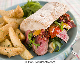 Steak and Roasted Pepper Ciabatta Sandwich with Spiced Potato Wedges