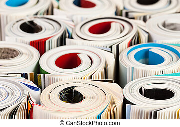 Colorful magazines up close - rolled up composition