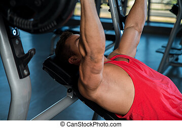 Bench Press Workout - Young Men In Gym Exercising On The...