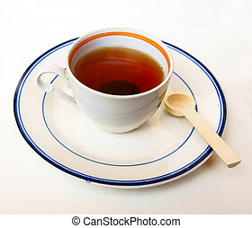Cup of tea on saucer on white background
