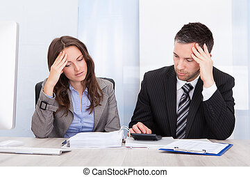 Worried Businesspeople Calculating Finance - Worried...