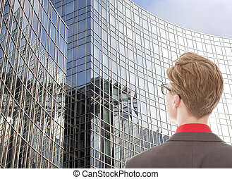 Young man looking at business office