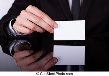 Businessman Holding Blank Visiting Card - Close-up Of A...