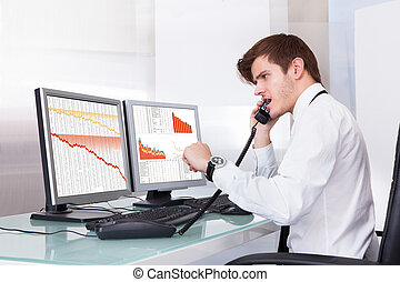 Frustrated Stock Broker Working At Office