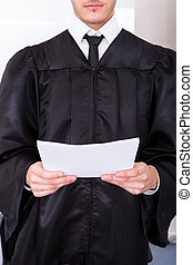 Male Judge Holding Documents - Close-up Of Male Judge In...